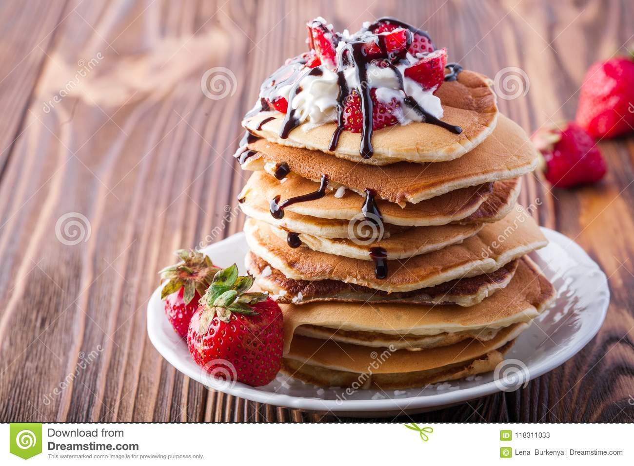 Stack Of Pancakes With Strawberries Whip Cream And Chocolate Syrup On A White Plate On A Wooden Background Stock Image Image Of Maple Fruit 118311033