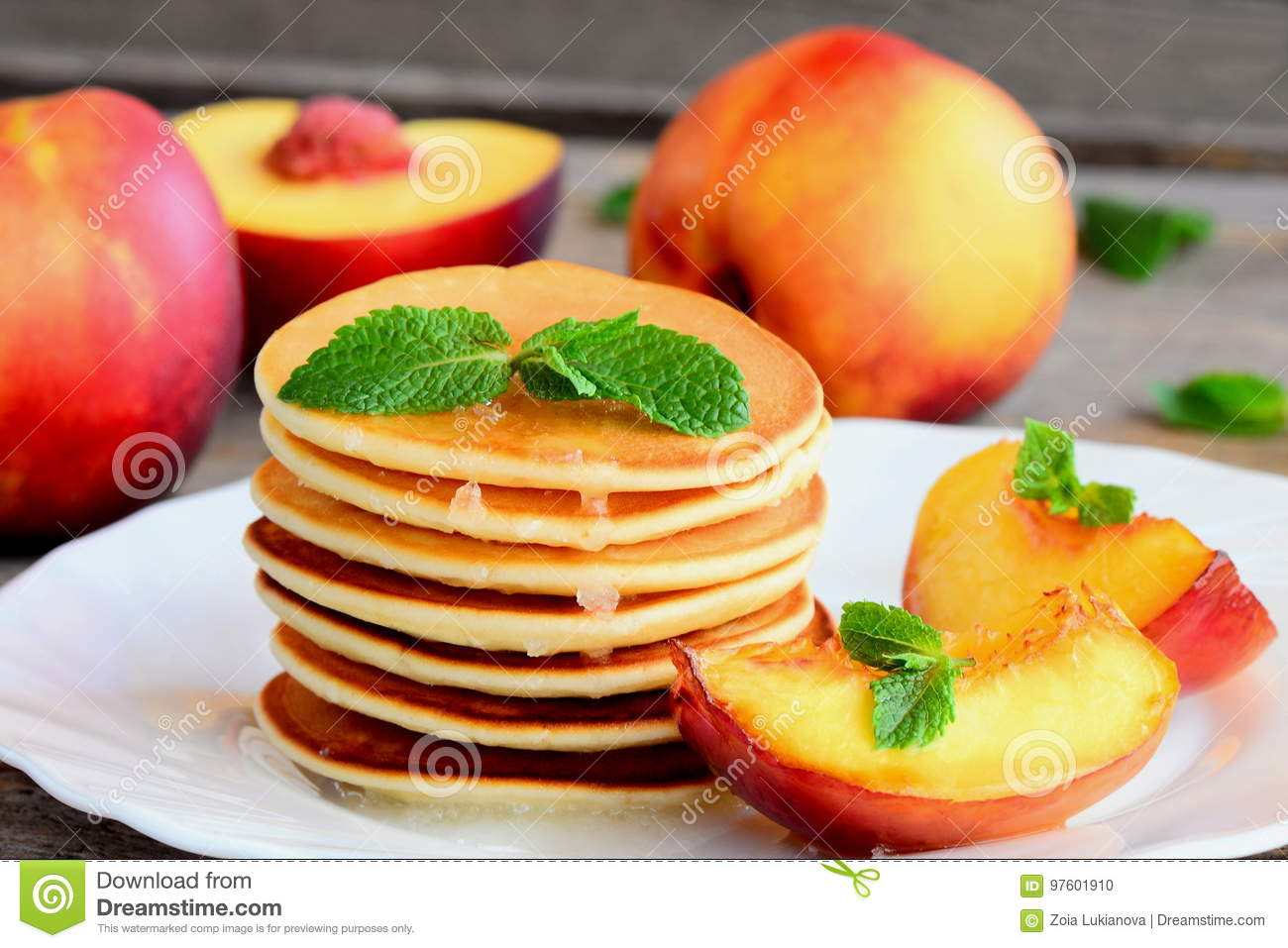 Stack of pancakes with syrup and grilled nectarines on a white plate fried pancakes stack fried pancakes recipe homemade pancakes recipe homemade pancakes photo delicious pancakes idea pancakes with fruit ccuart Images
