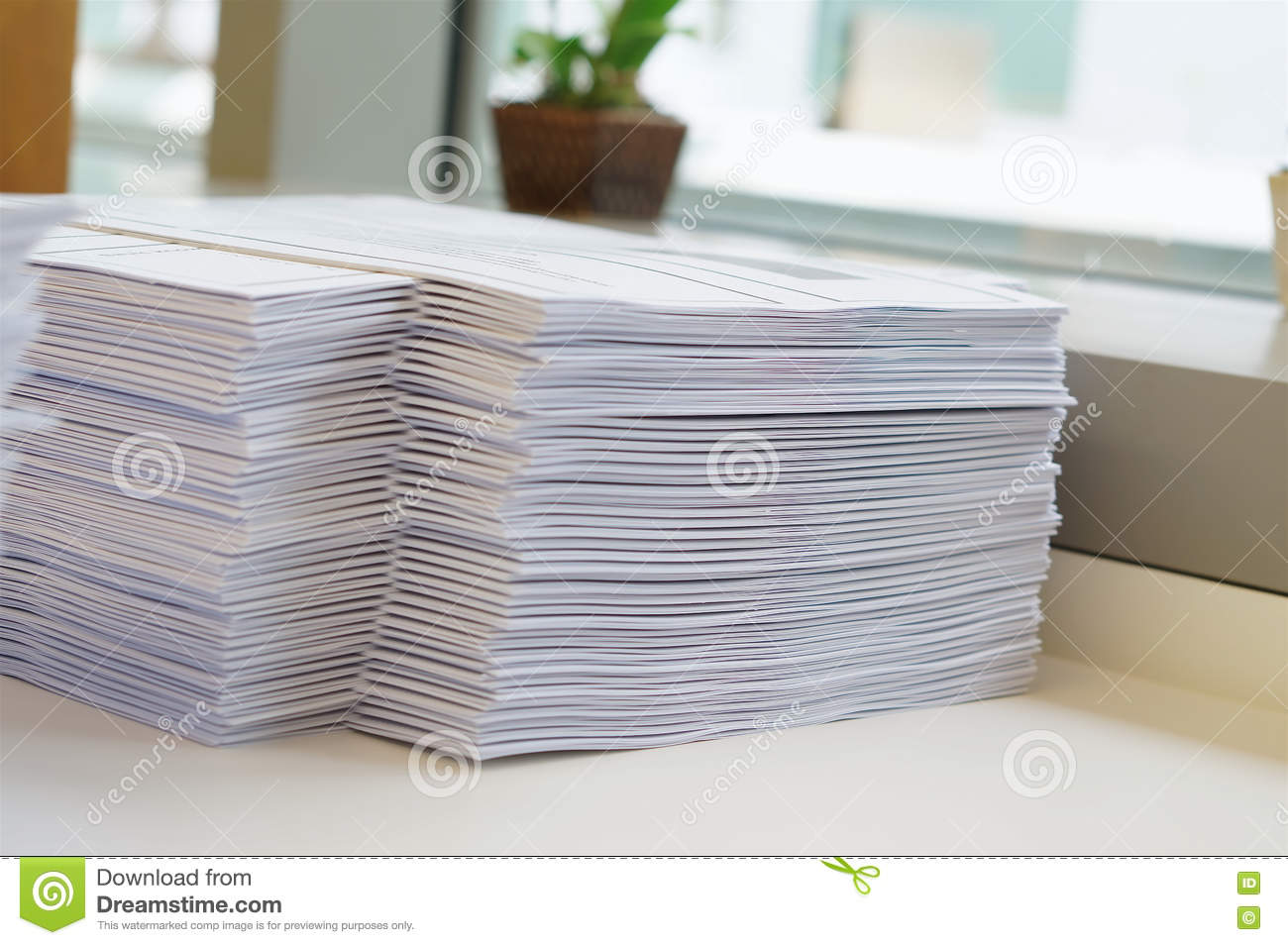 Stack of papers worksheet near window