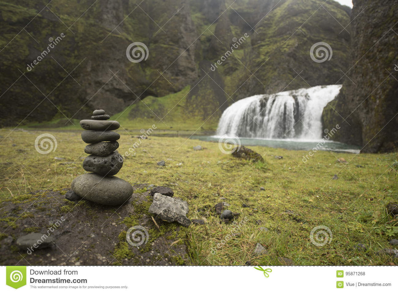 Stack Of Pebbles And Waterfall Stock Photo - Image of