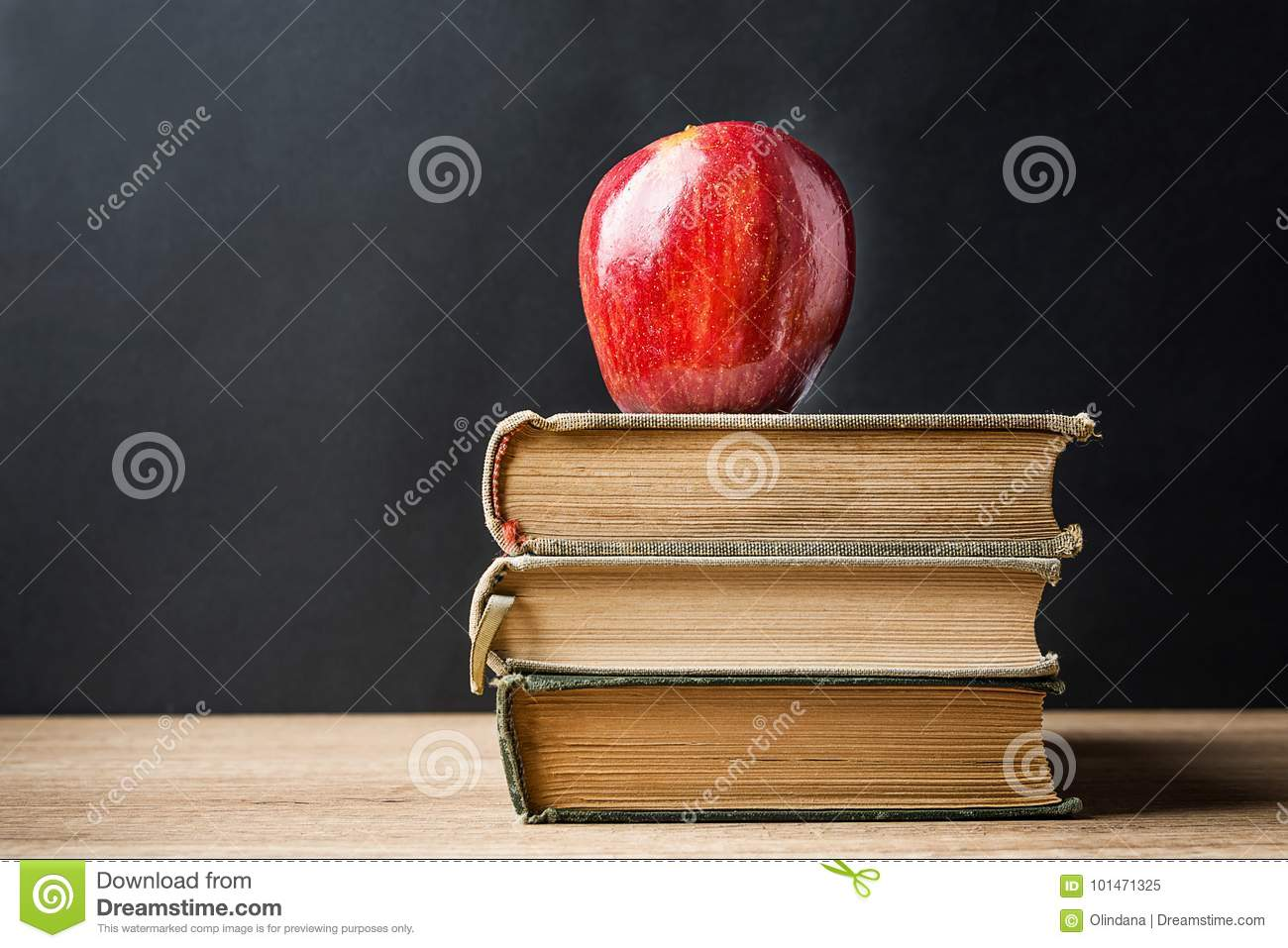 Stack Pile of Old Books Red Glossy Apple on Top. Learning Education Knowledge Concept. Blackboard Background. Classrom.