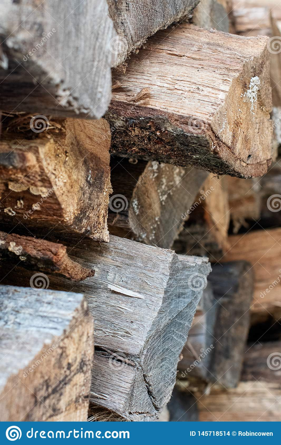 Close Up of Stacked Wooden Logs Background