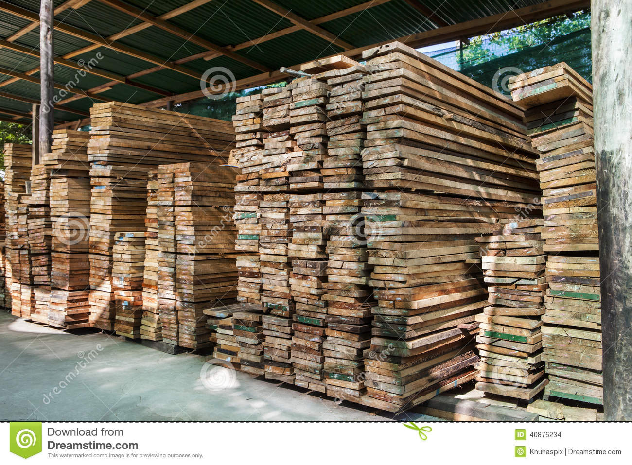 Stack of pile wood bar in lumber yard factory use for