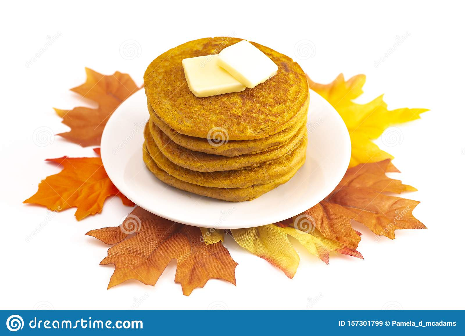 Stack of Pumpkin Spice Flavored Pancakes Isolated on a White Background