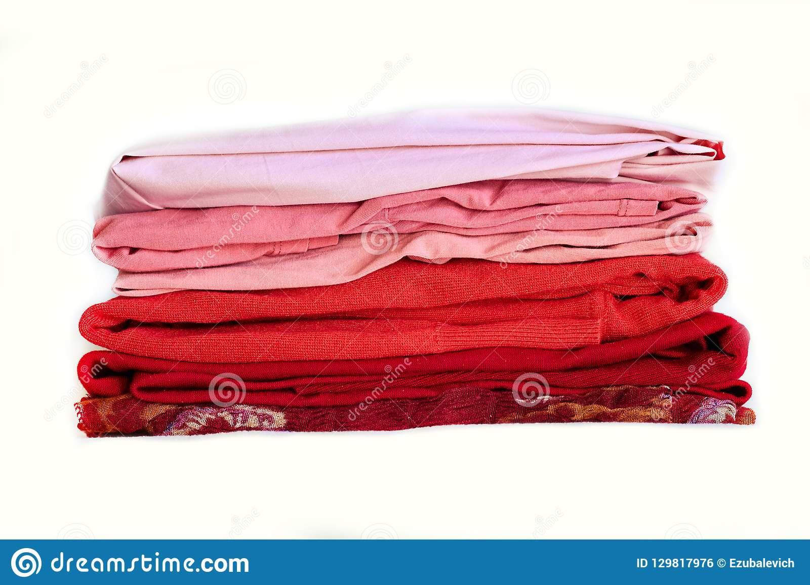 Stack purple winter clothes isolated on white background.