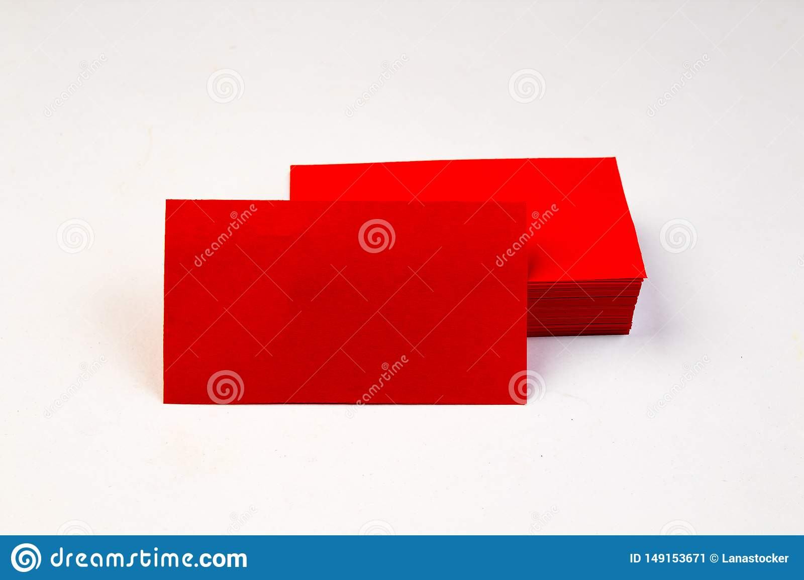 Stack of red blank business cards on white background.