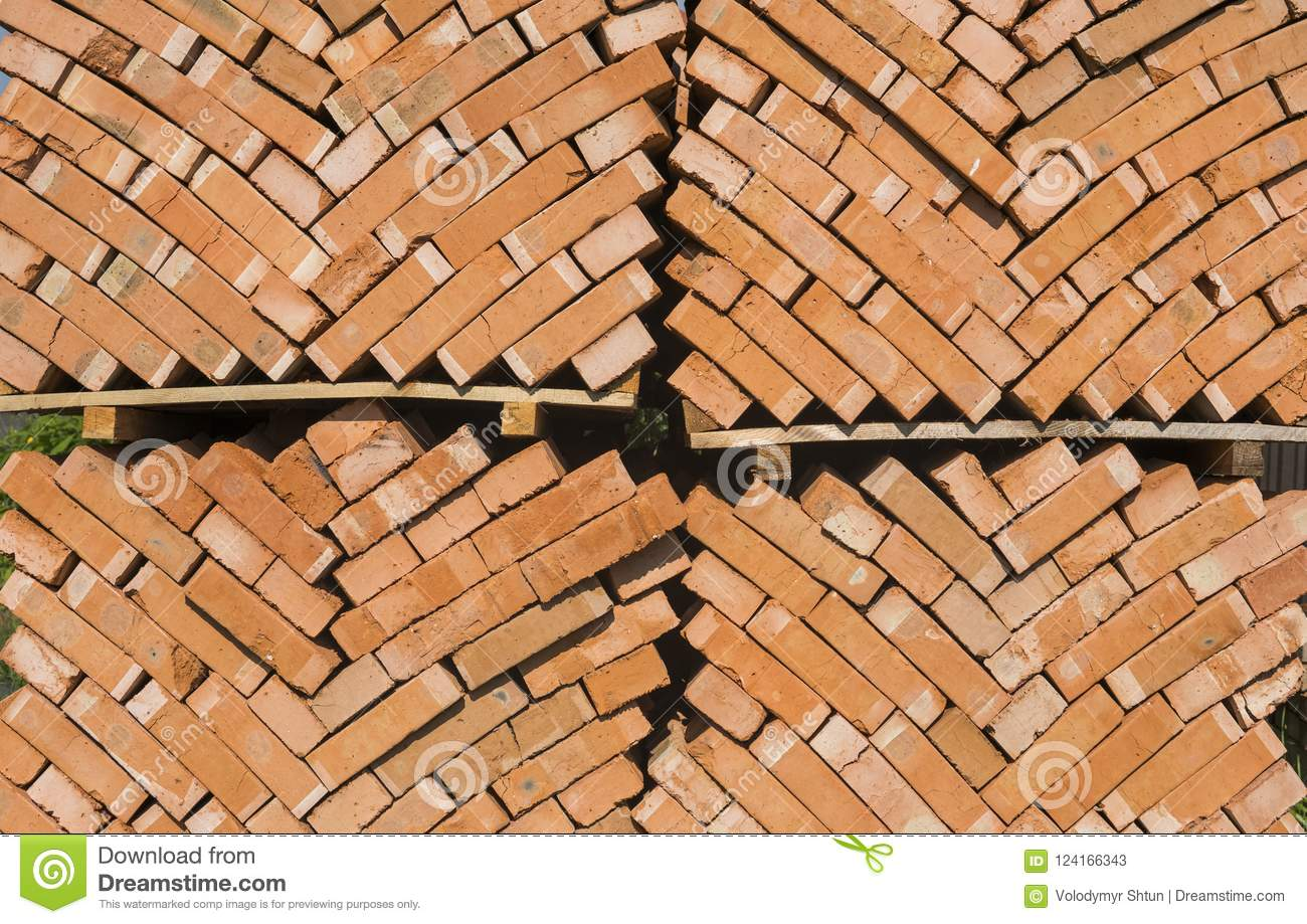 Stack of red bricks as a background or texture.