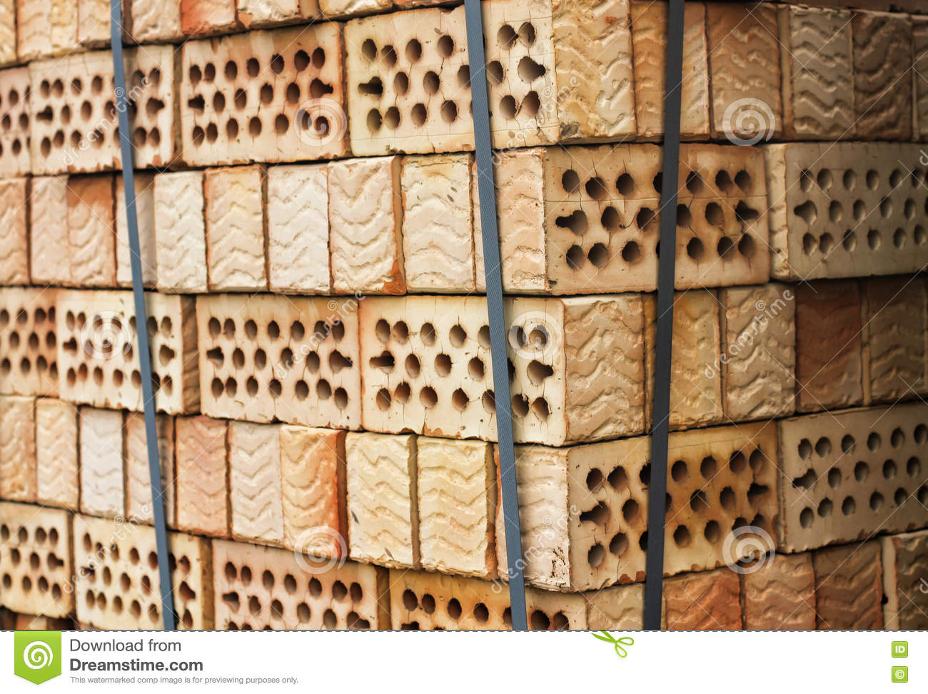 A Stack Of Red Clay Bricks With Holes