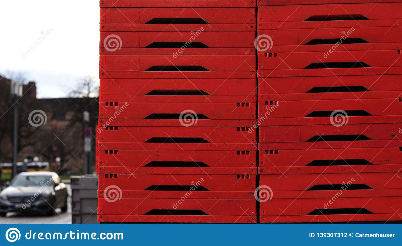 Stack of red foldable plastic boxes