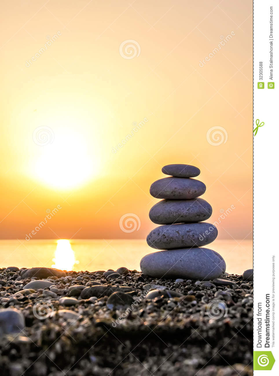 stack of stones against golden sunset stock photo image