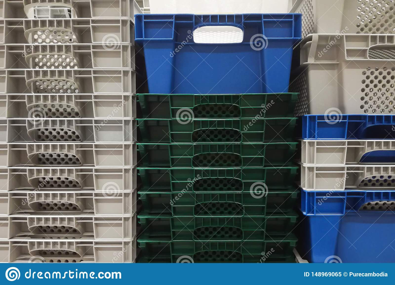 Stack Storage of new colourful white, grey and blue plastic container boxes