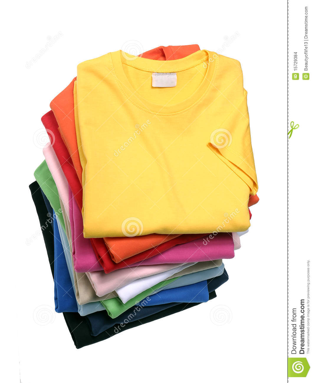 Stack Of T shirts Shot In The Studio Are Isolated