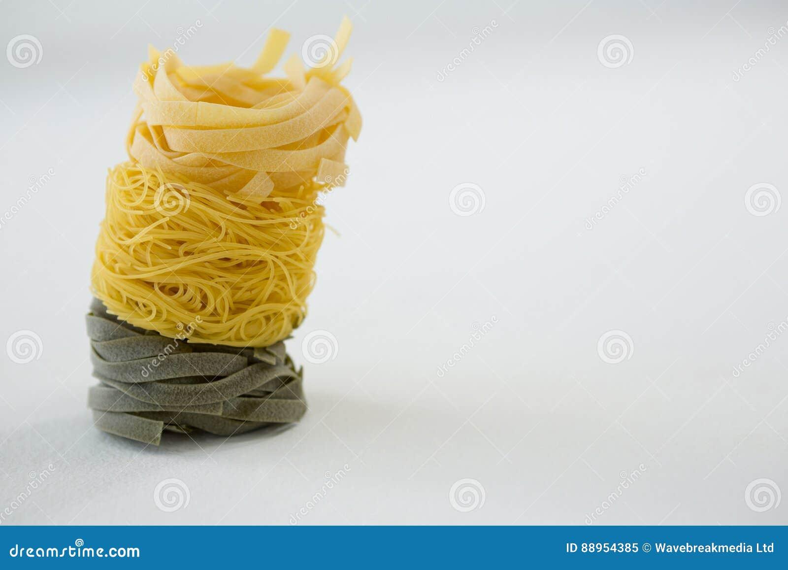 stack of tagliatelle and capellini pasta stock photo image 88954385