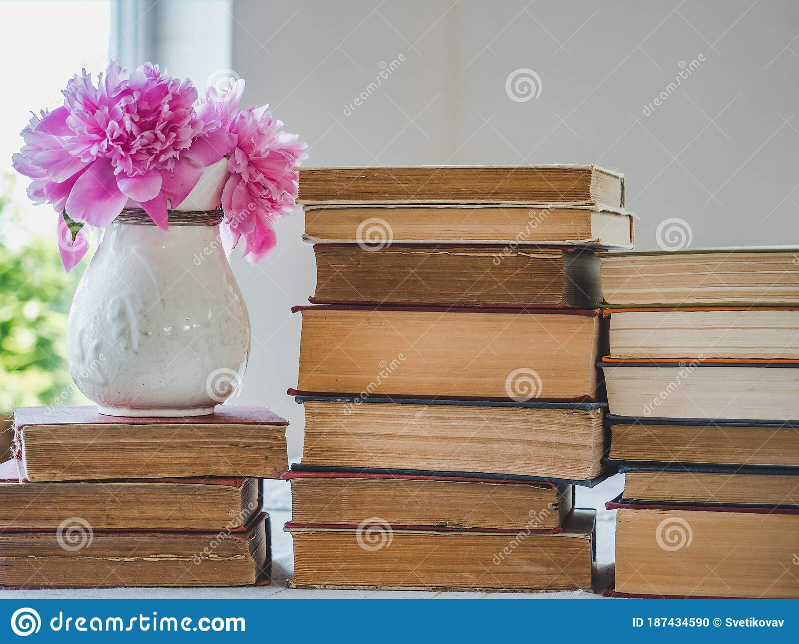 Stack Of Vintage Books And Beautiful Flowers Stock Photo Image Of Reading Happy 187434590