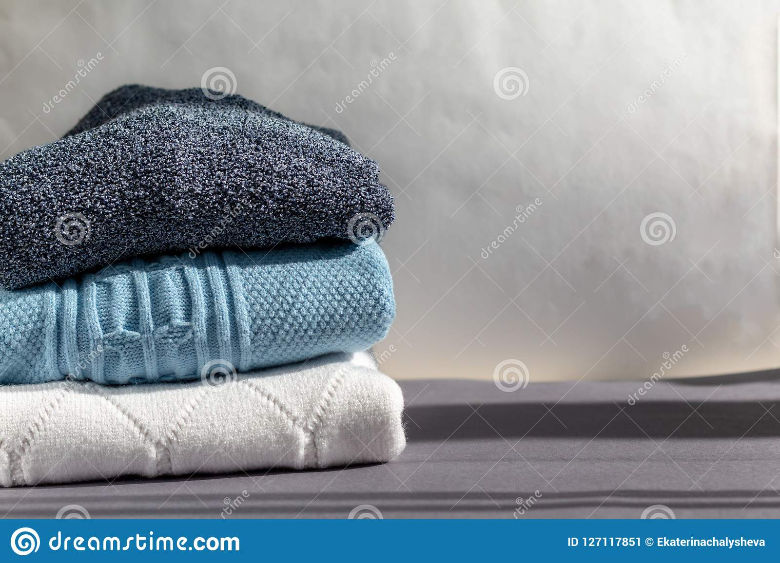 A stack of warm winter sweaters