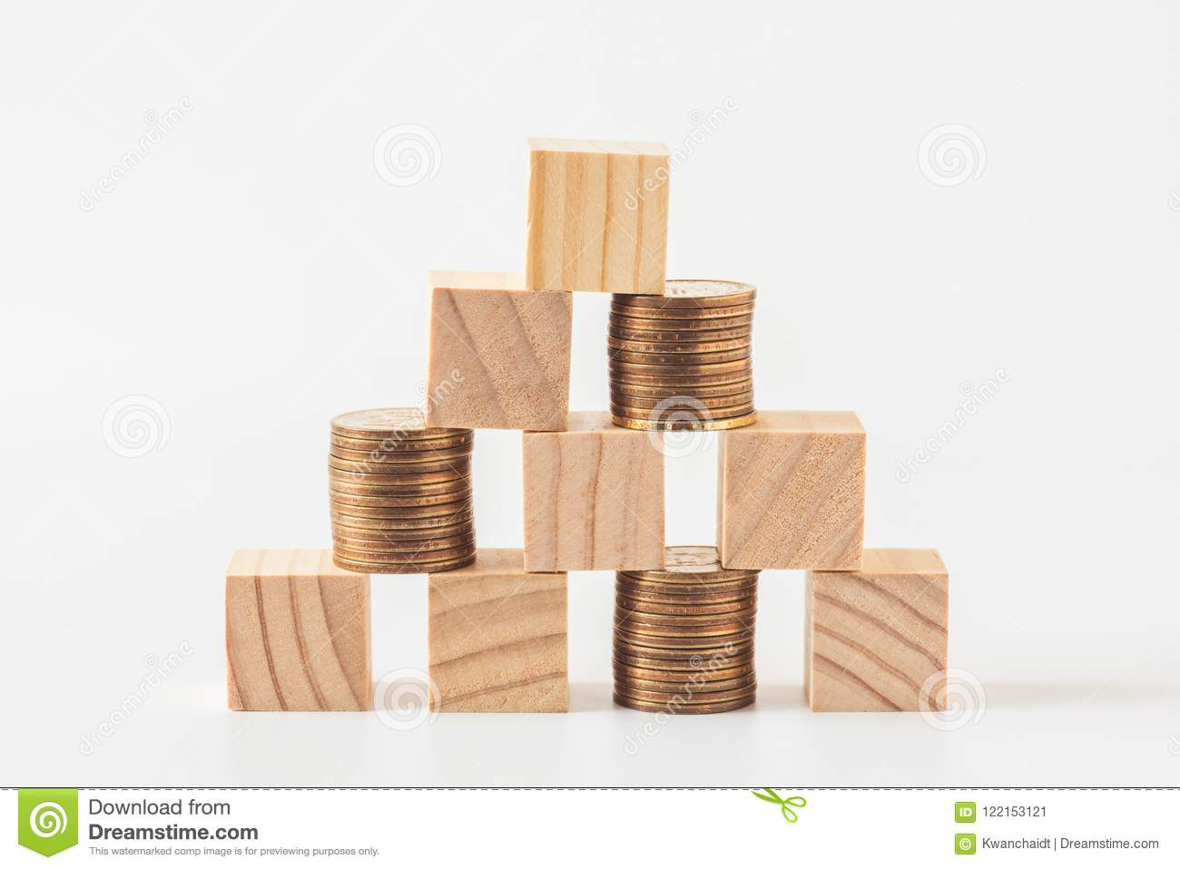 Stack Of Wood Cube Building Blocks And Money Coins Stock Image
