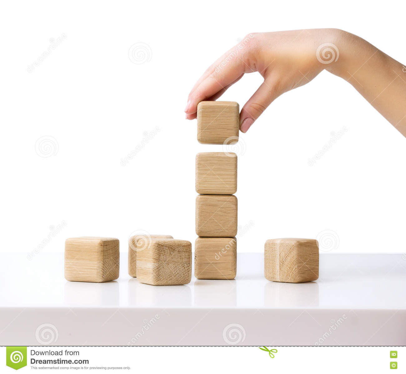 stack wooden cubes hand establishes block tower isolated stock