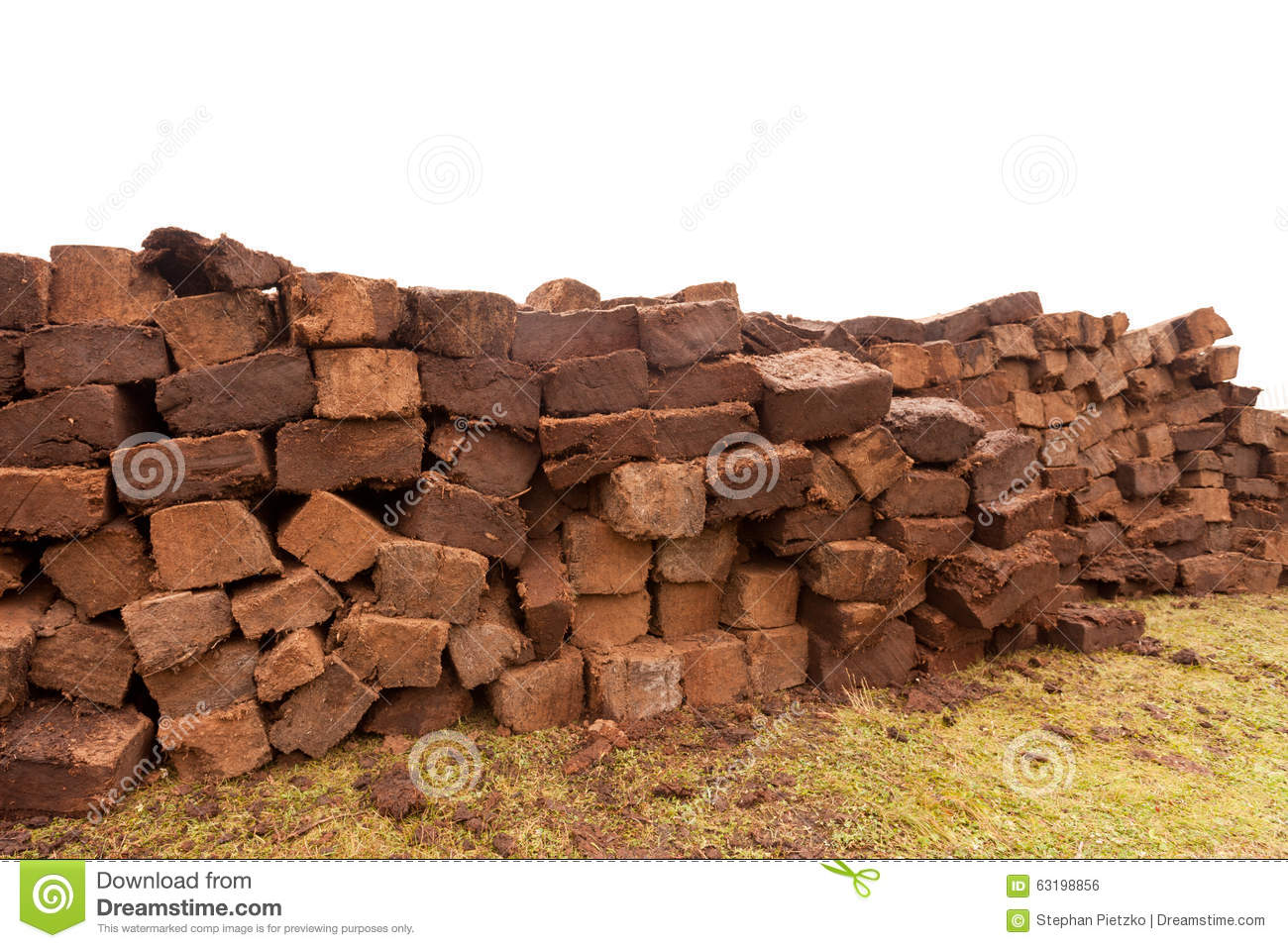 Stacked bog peat turf briquette cuttings drying