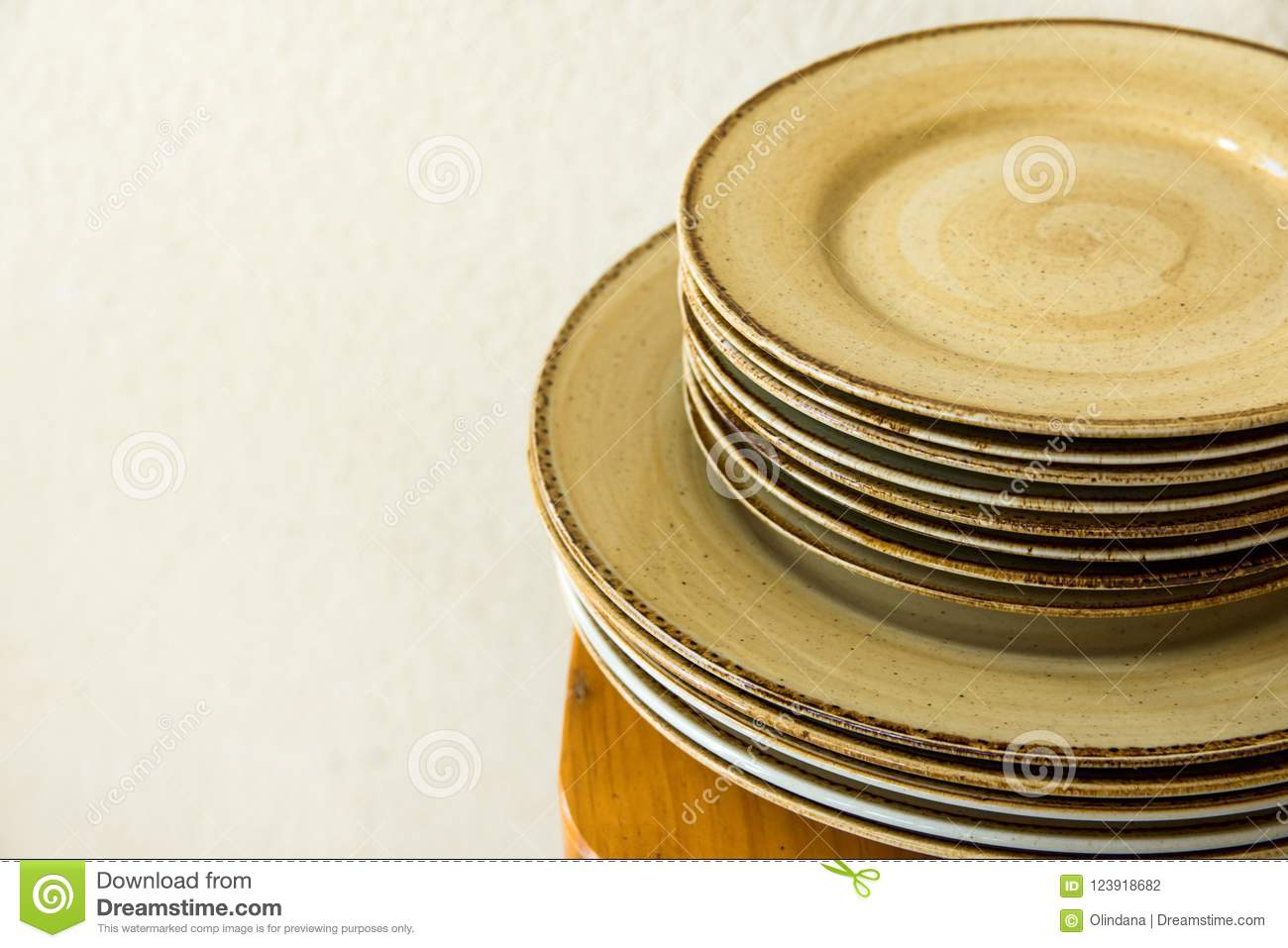 Stacked Brown Speckled Glazed Earthenware Ceramic Plates Dishes On ...