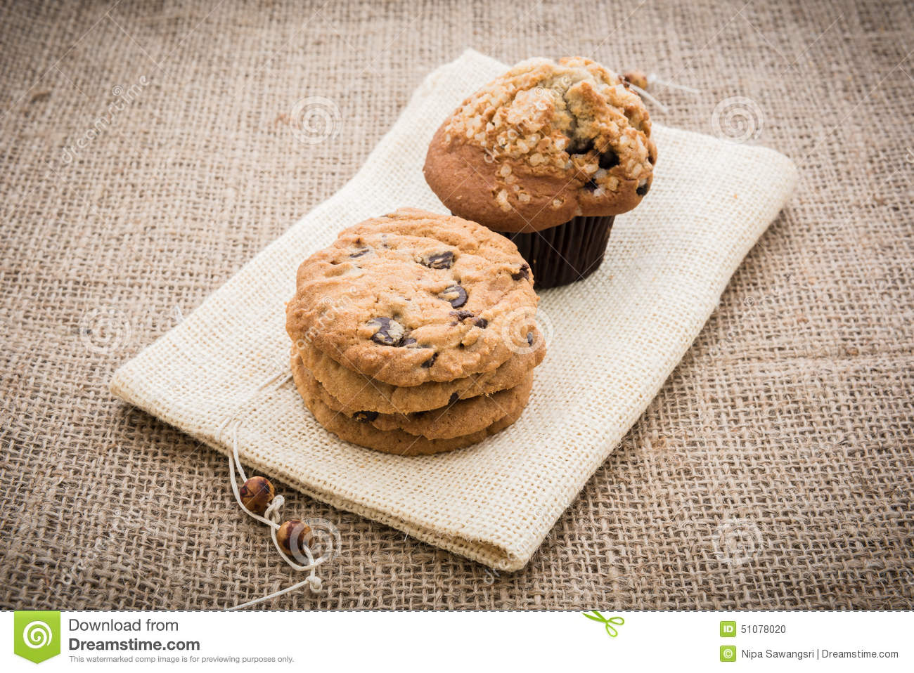 Stacked Chocolate Chip Cookies And Cupcakes On Brown Napkin Over Stock ...