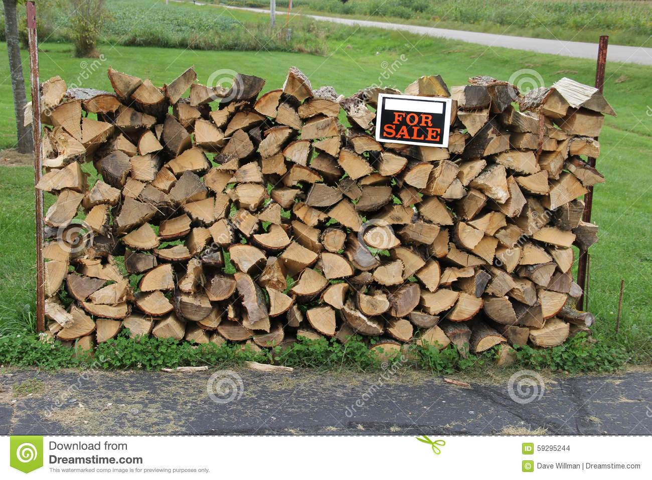 Stacked face cord of split firewood stock photo image