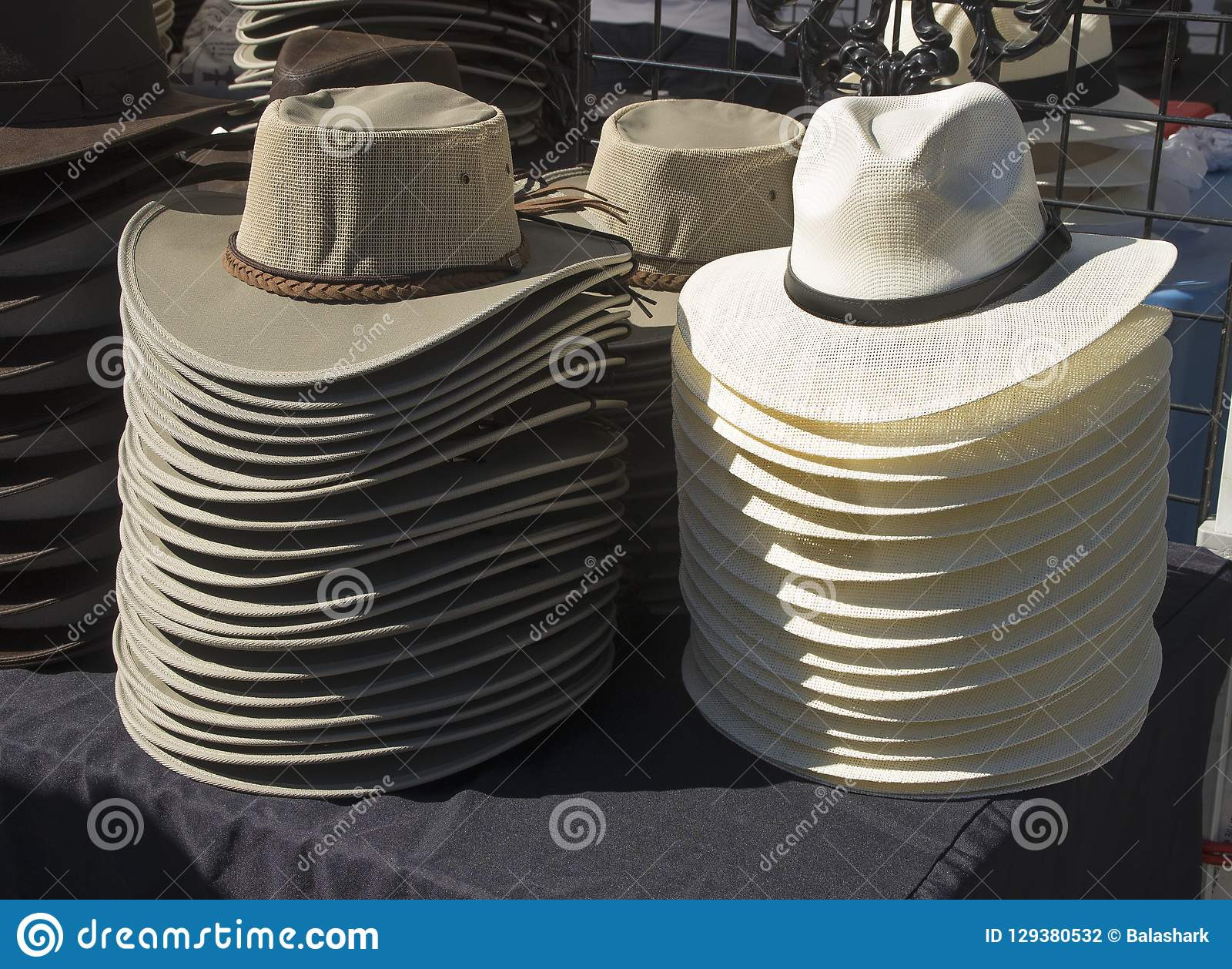 586ce46e333691 Hats are stacked high at a vendors at Mumfest in New Bern,North Carolina