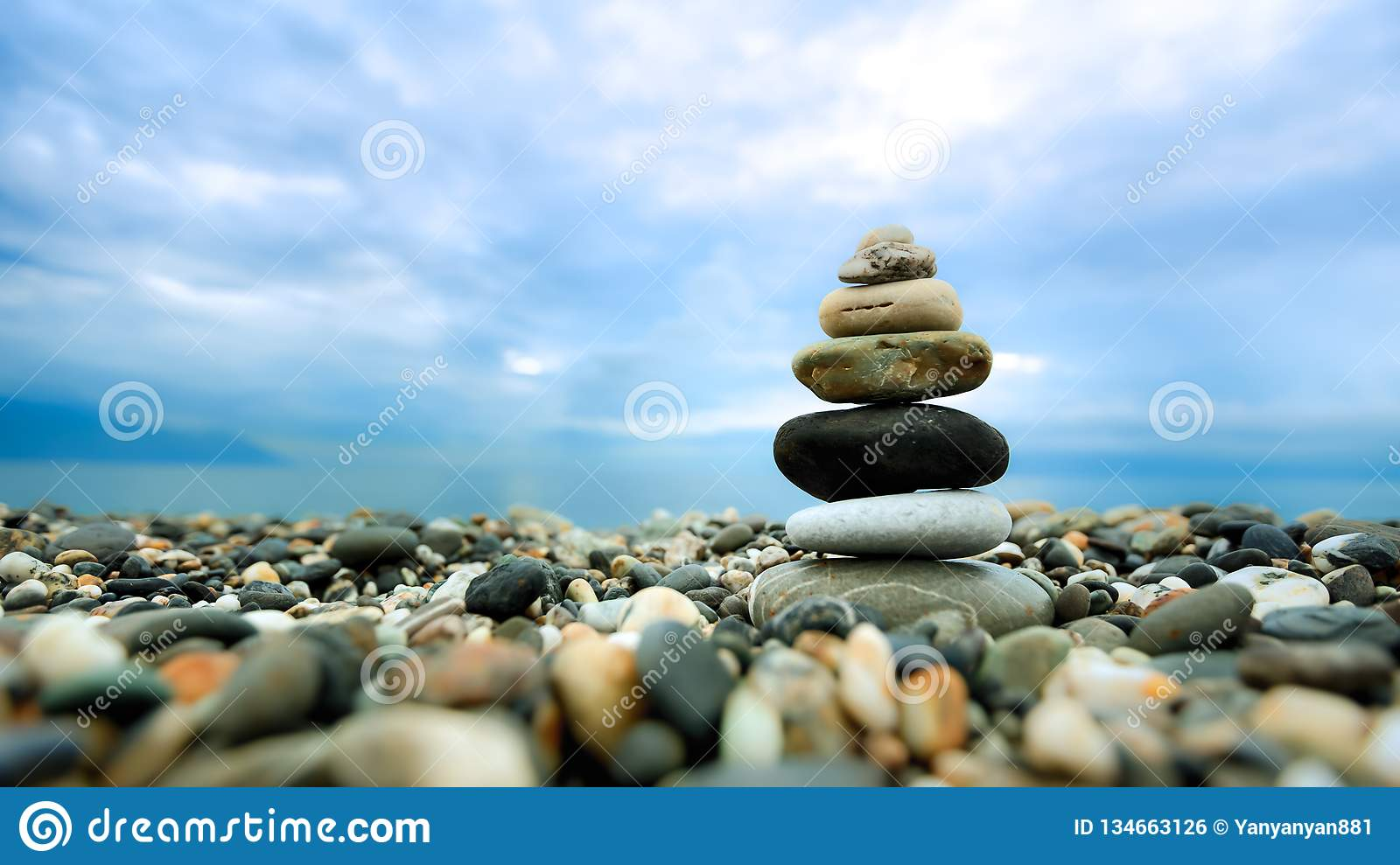 Stacked pebbles along the beach