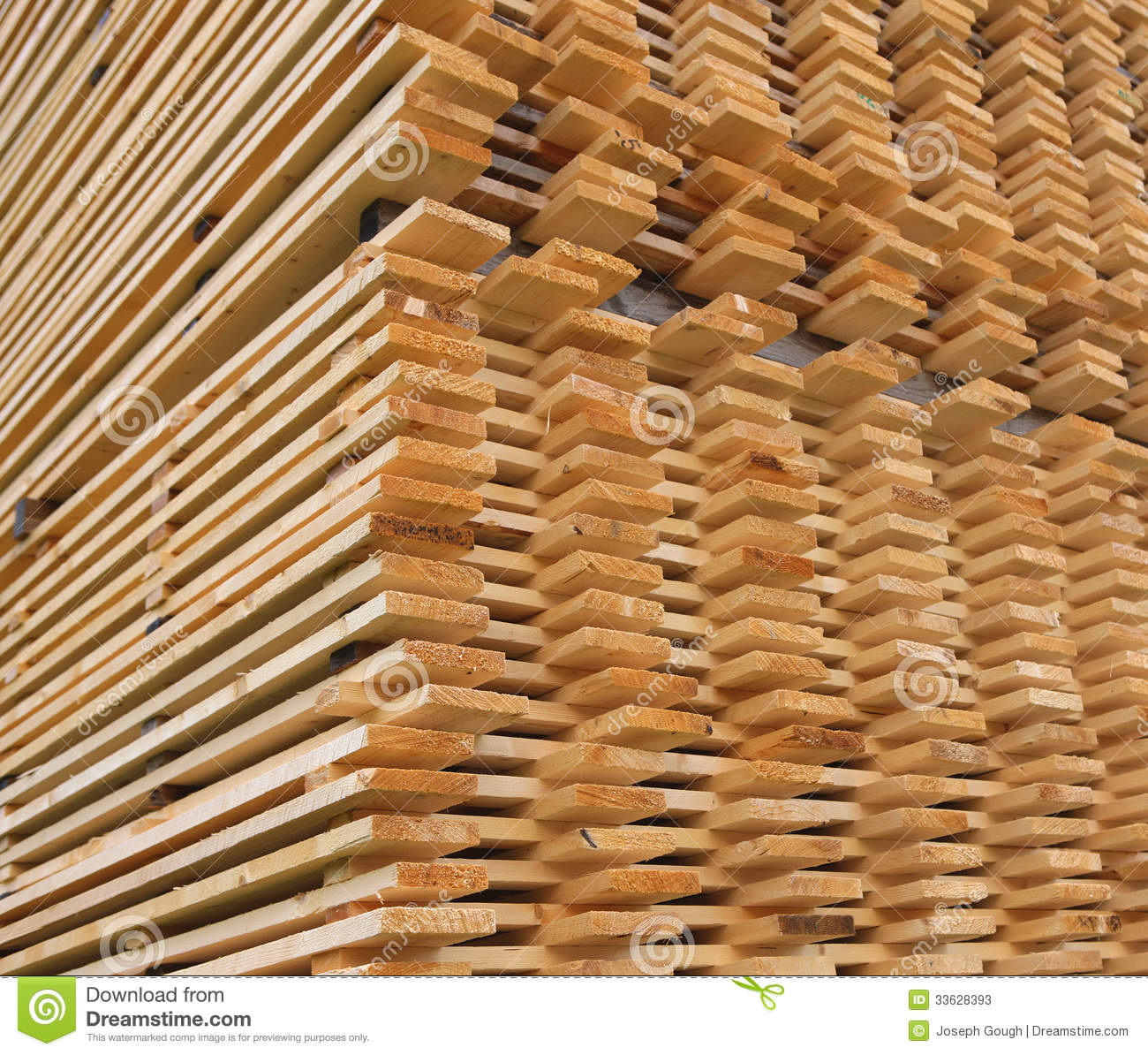 Stacked pine timber planks drying stock image of
