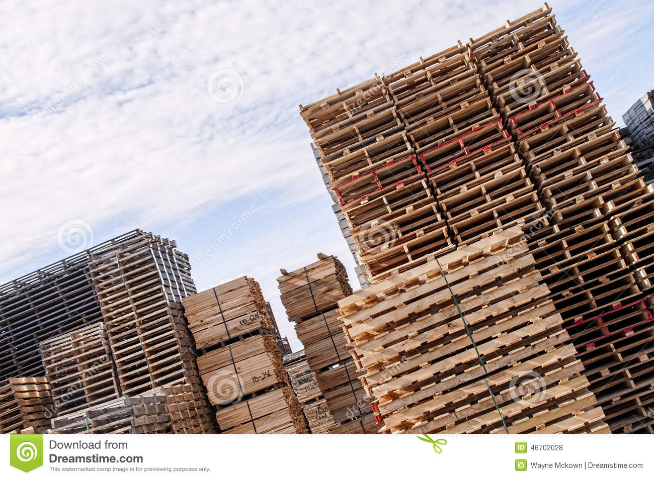 Stacked wood pallets and material