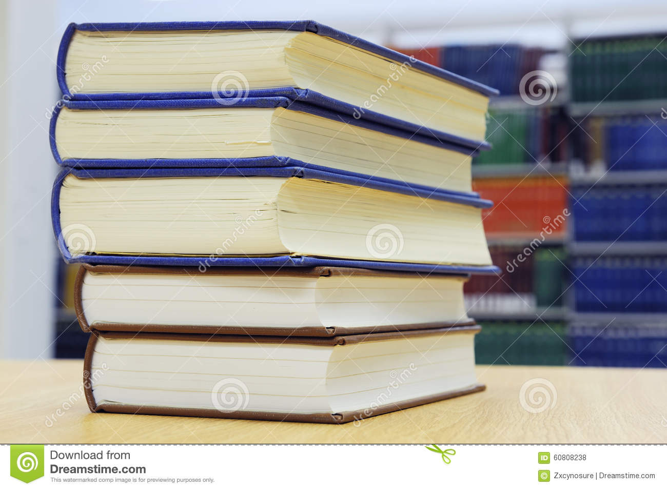 stacking books on library table stock photo - image: 60808238