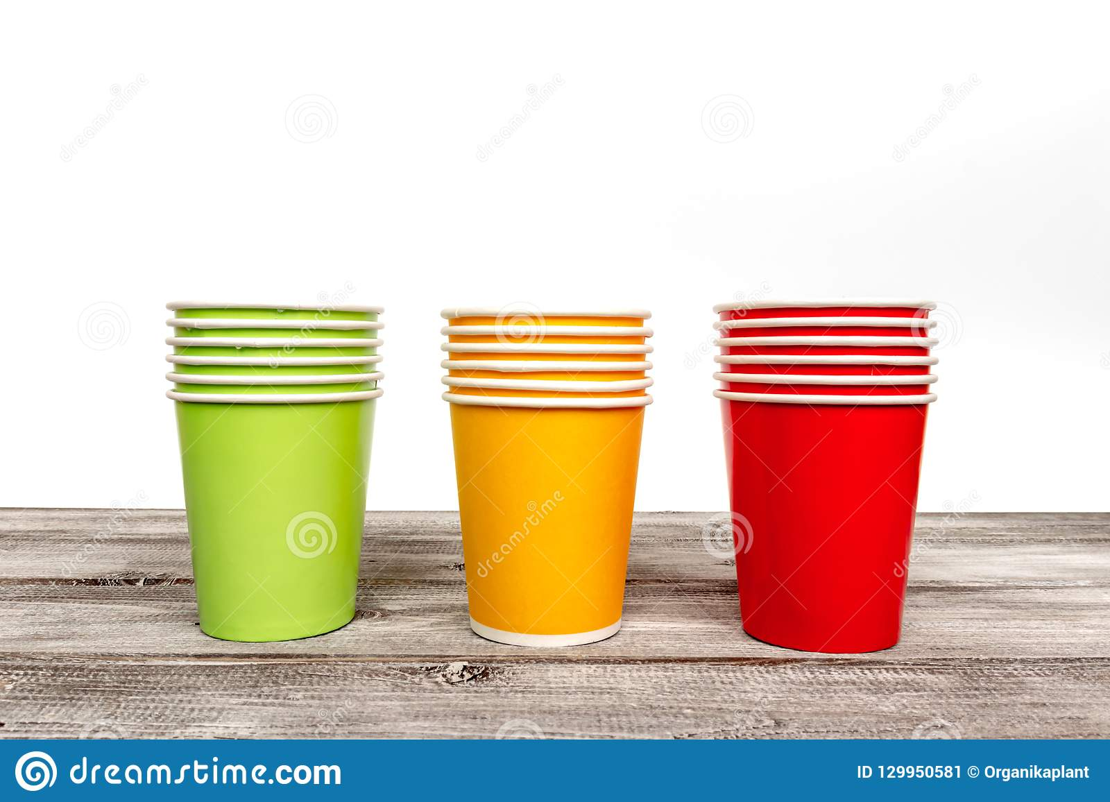 Stacks Of Empty Colorful Disposable Paper Cups Of Red