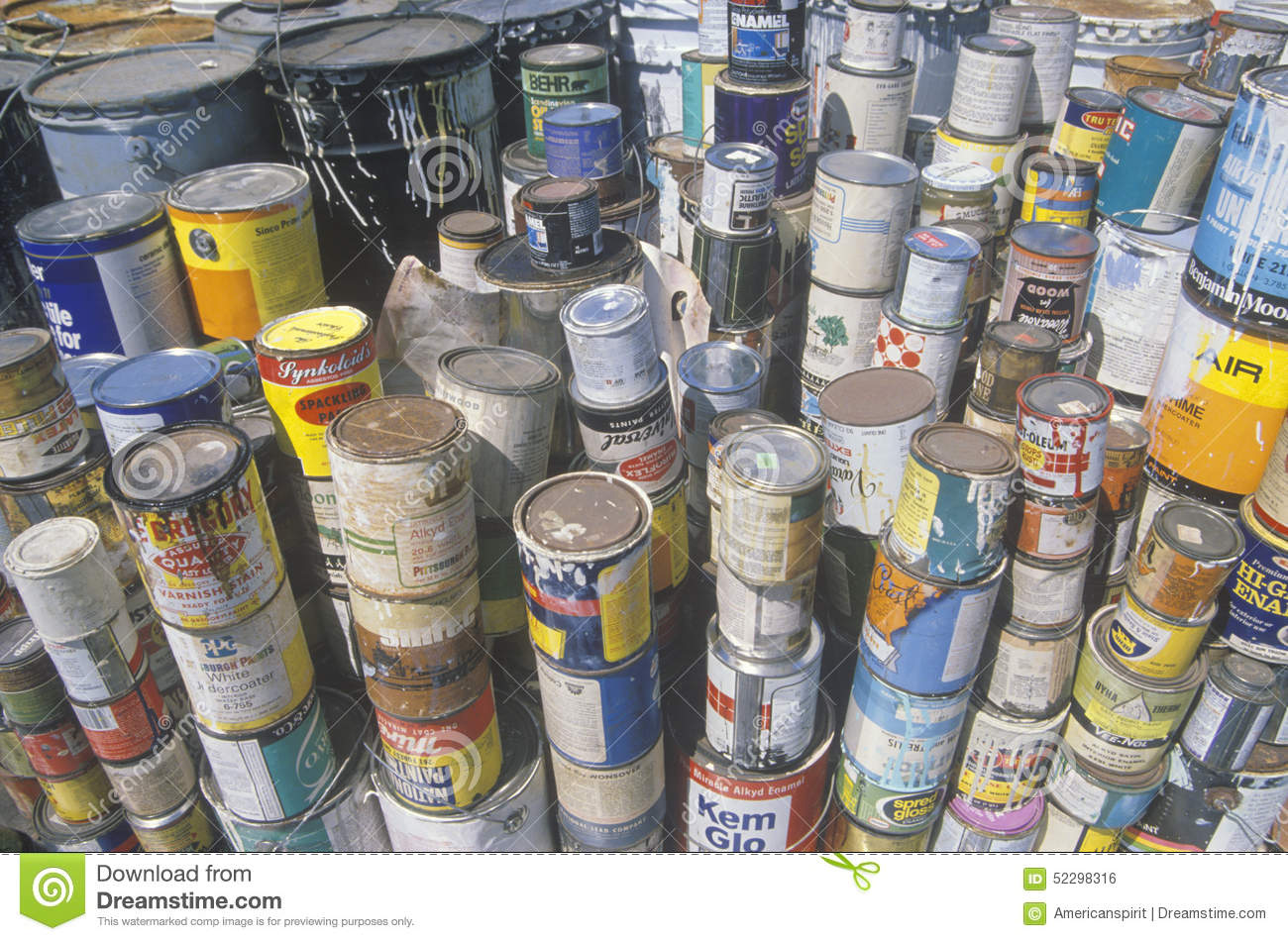 stacks of toxic paint cans waiting for disposal at a