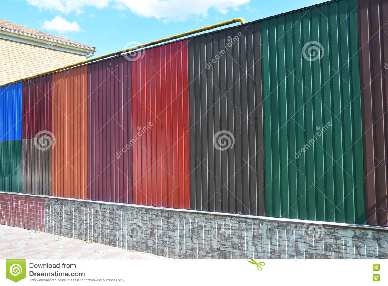 Stacks Of Various Colorful Metal Fence Panels And Metal