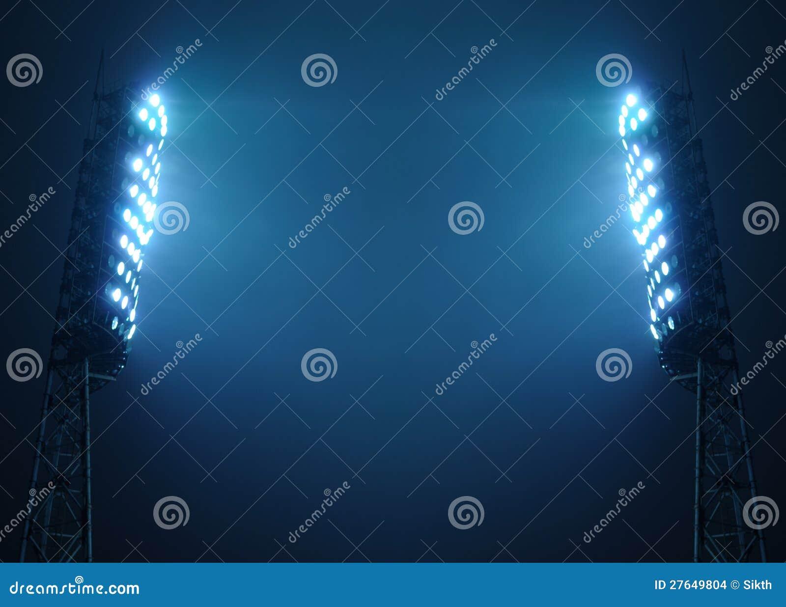 StadionFloodlights mot den mörka nattskyen