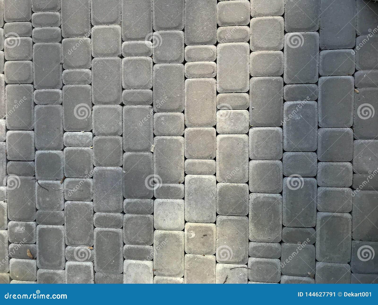 Stads- gr? bakgrund f?r grov grunge av stenl?gga tjock skiva f?r stenfyrkant