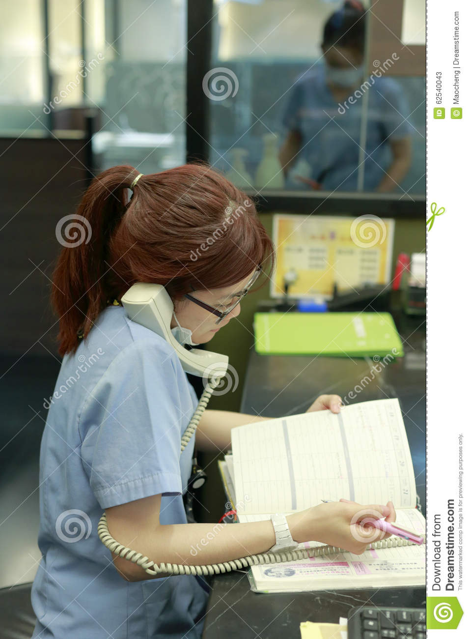 Abc Dental Care staff of abc dental hospital call and record editorial stock