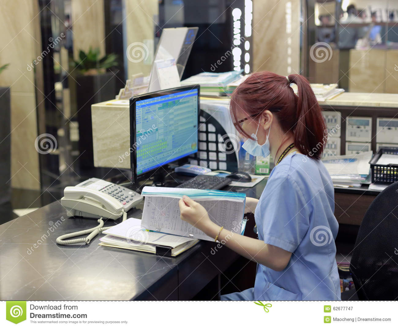 Staff of abc dental hospital working next to computer