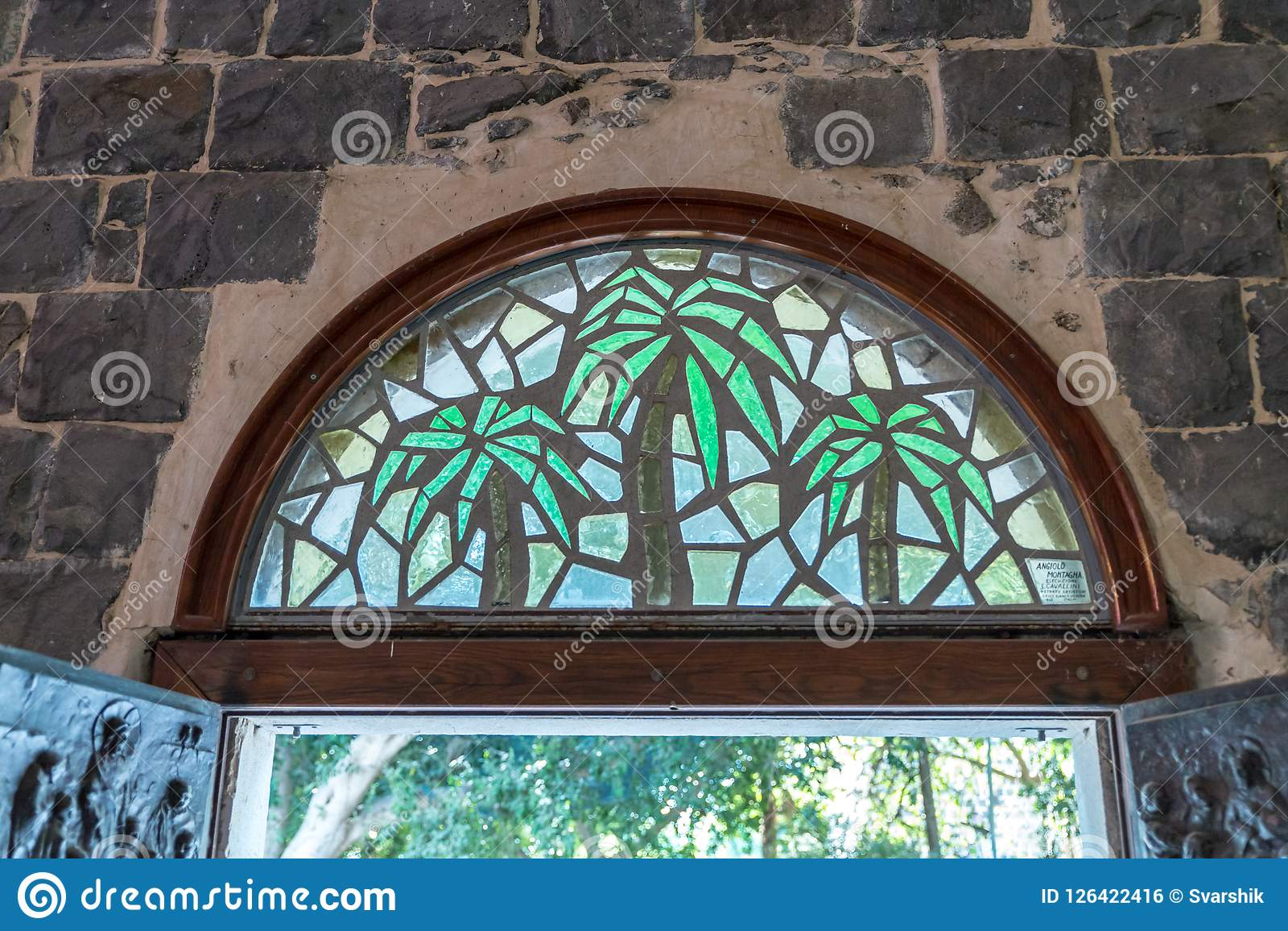 Stained Glass Window Above The Front Door To The Church Of The