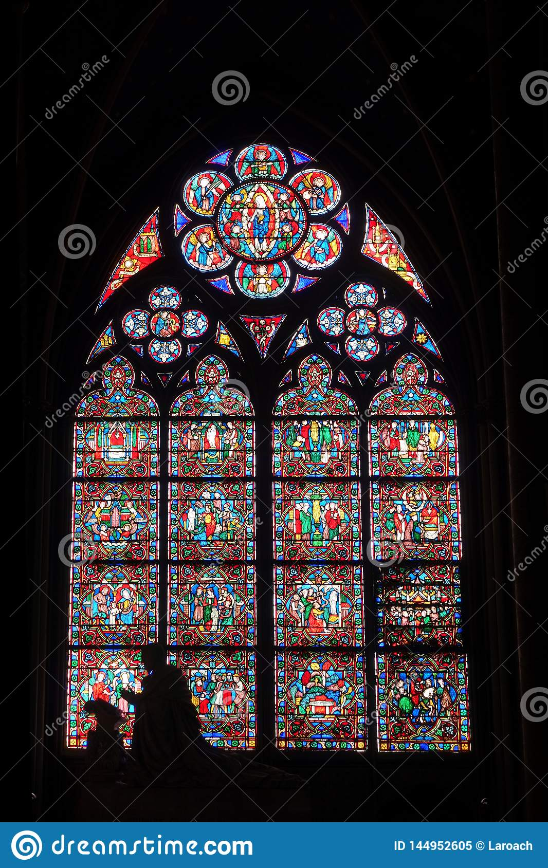 Stained Glass Window with Silhouette Interior Notre Dame Cathedral