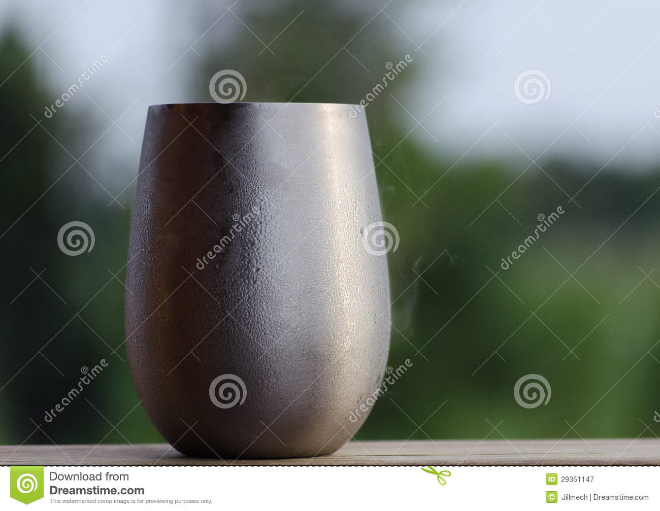 frosty beverage in silver stainless steel stemless