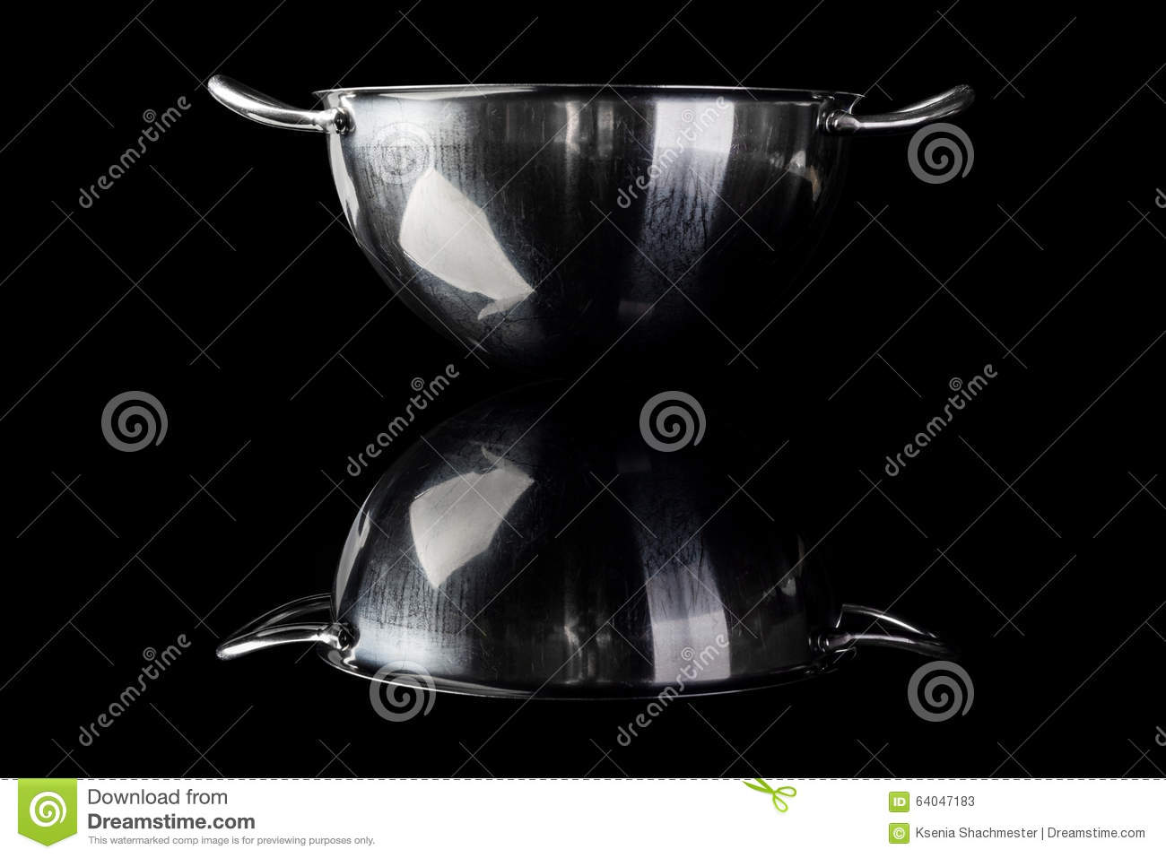 Stainless steel bowl from side on black with reflection