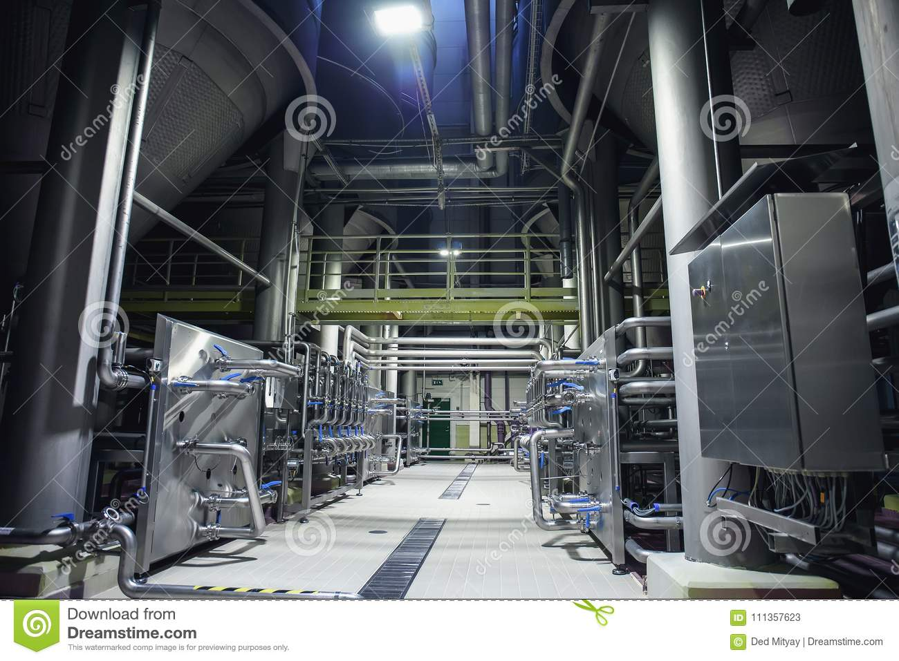 Stainless Steel Brewing Equipment : Large Reservoirs Or Tanks And Pipes In Modern  Beer Factory.