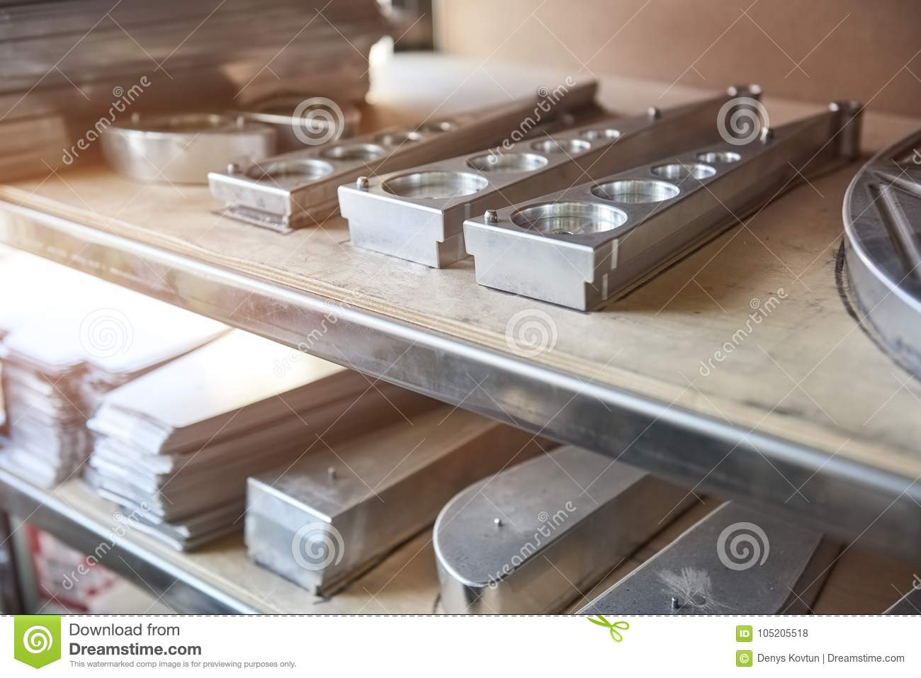 Stainless steel parts on shelf.