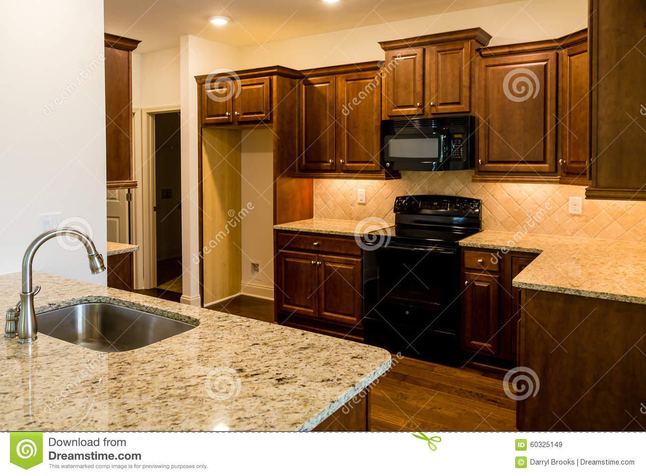 Stainless steel sink and black appliances stock image for Kitchens with black appliances