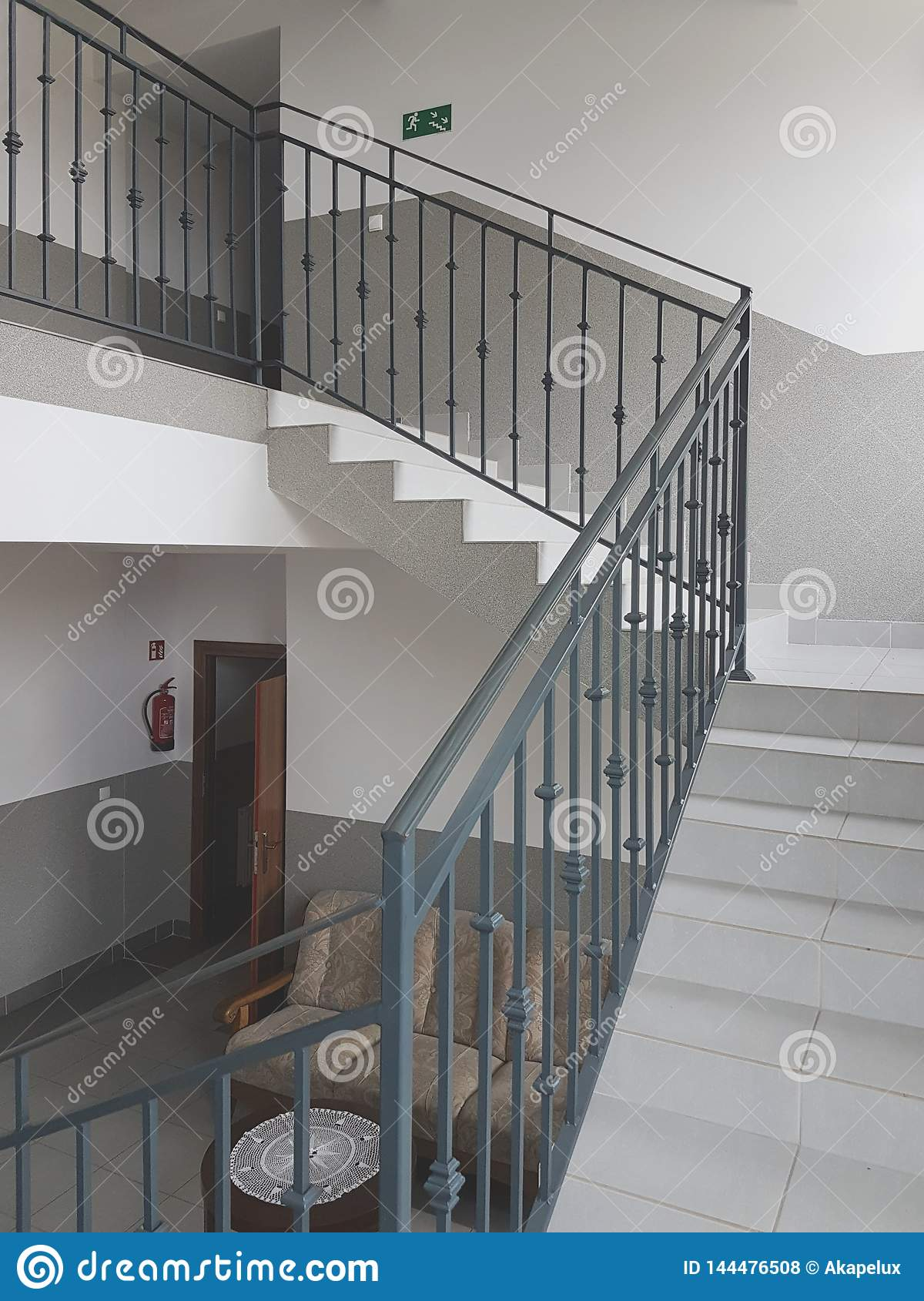 A Staircase With Forged Cast Iron Railings In A Modern Building Illuminated With Light From The Windows Interior Staircase And Editorial Stock Photo Image Of Roof Handrail 144476508