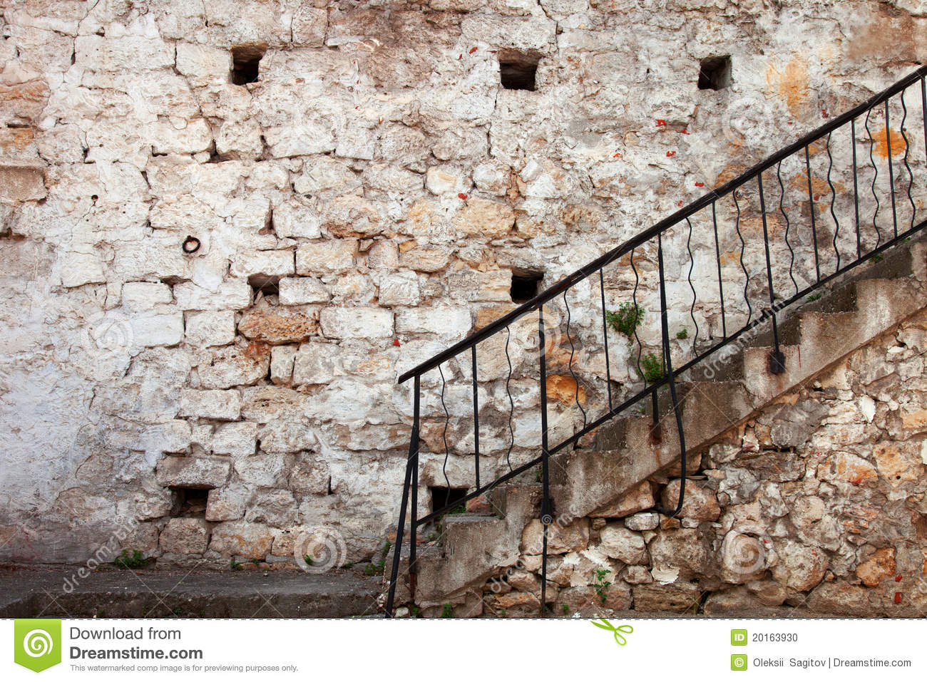 Stairs With Railing Against The Old Stone Walls Stock