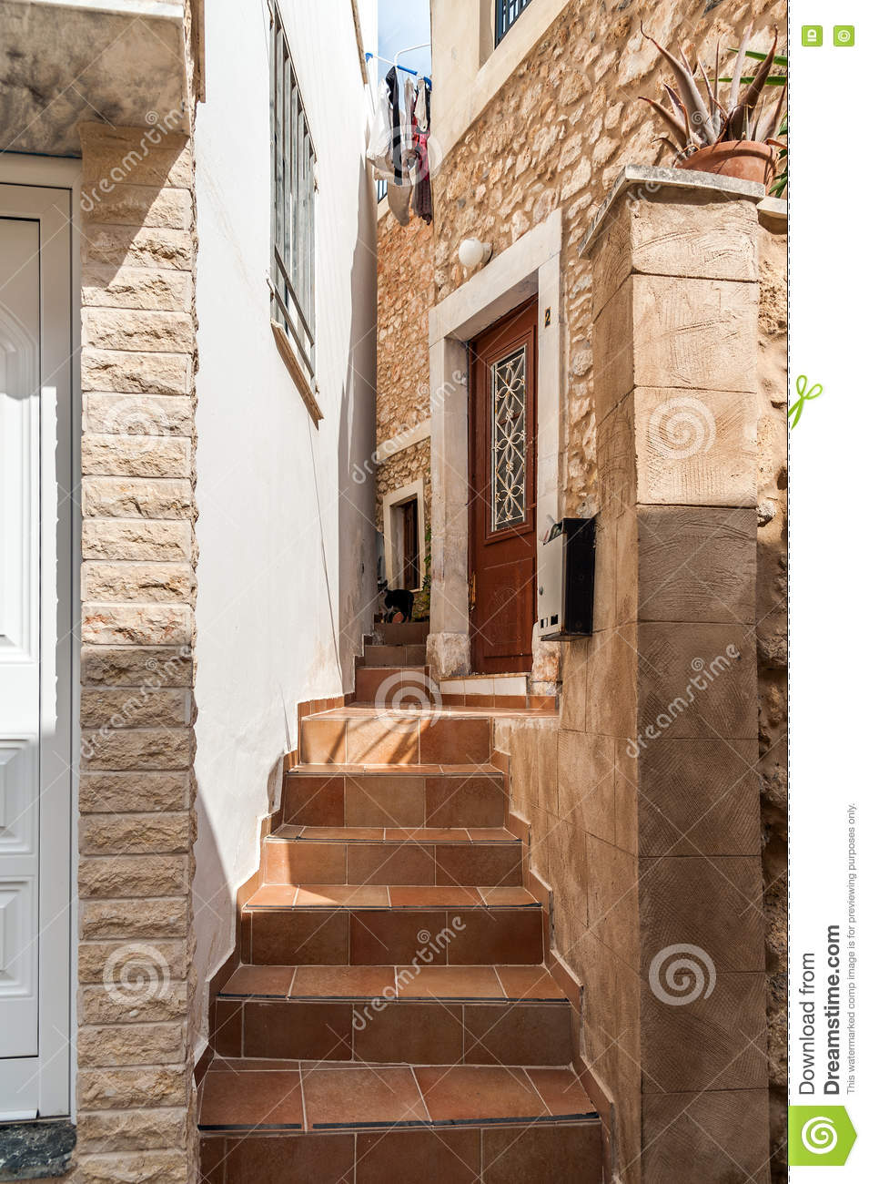 Traditional Greek Houses stairs between traditional greek houses at narrow street of sitia