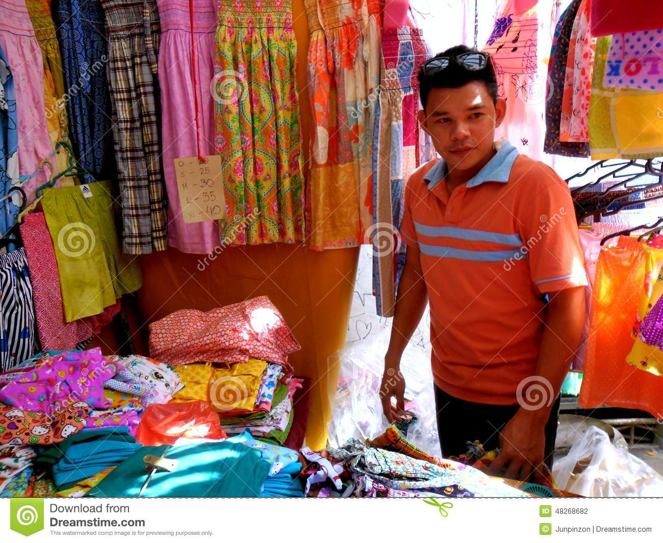 stall owner selling clothes in taytay rizal philippines