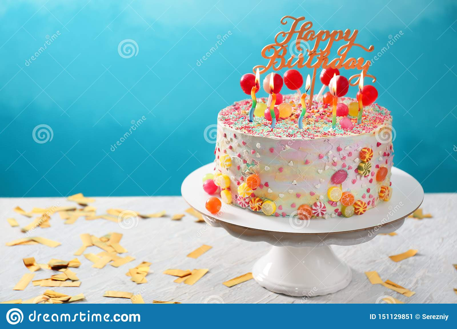 Sensational Stand With Beautiful Tasty Birthday Cake On Table Against Color Funny Birthday Cards Online Overcheapnameinfo