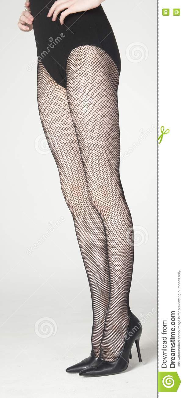 Standing Legs In Pantyhose And Black Heels Stock Photo